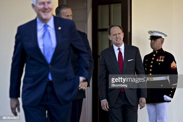 Senator Patrick Toomey a Republican from Pennsylvania right walks out of the White House to speak to the media after a Senate Finance Committee...