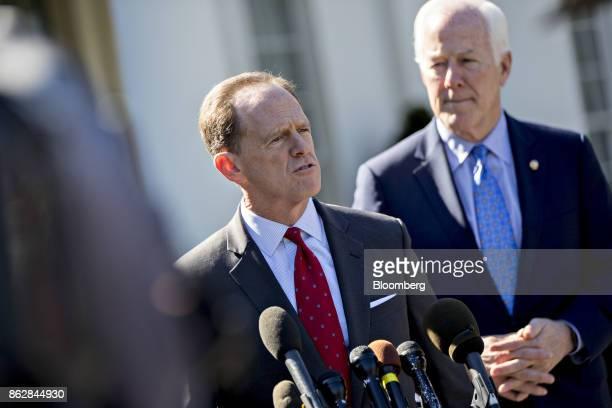 Senator Patrick Toomey a Republican from Pennsylvania speaks to members of the media as Senator John Cornyn a Republican from Texas right listens...