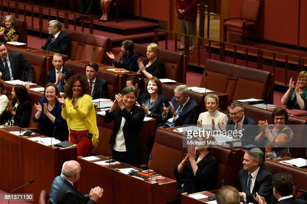 Senator Penny Wong and other Senators celebrating the result of a vote passing the marriage eqaulity bill in the Senate at Parliament House on...