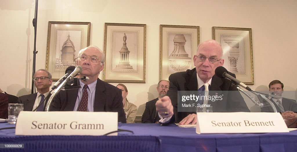 Senator Phil Gramm (R-TX) and Senator Robert F. Bennett (R-UT) listen to the testimony of the Secretary of Treasury, Paul O'neil.