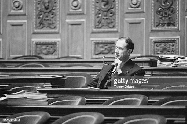 Senator Philippe de Gaulle listens as Albin Chalandon minister of justice introduces a bill on prison privatization during a session of the French...