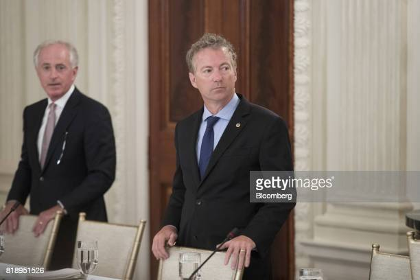Senator Rand Paul a Republican from Kentucky right and Senator Bob Corker a Republican from Tennessee stand next to seats before the start of a lunch...