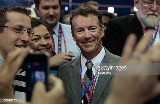 Senator Rand Paul a Republican from Kentucky stands for a photograph with delegates at the Republican National Convention in Tampa Florida US on...
