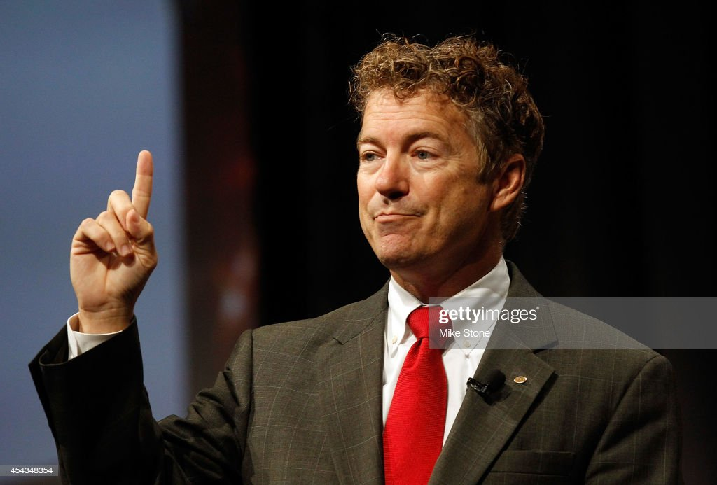Rand Paul And Rick Perry Address Defending the American Dream Summit : News Photo
