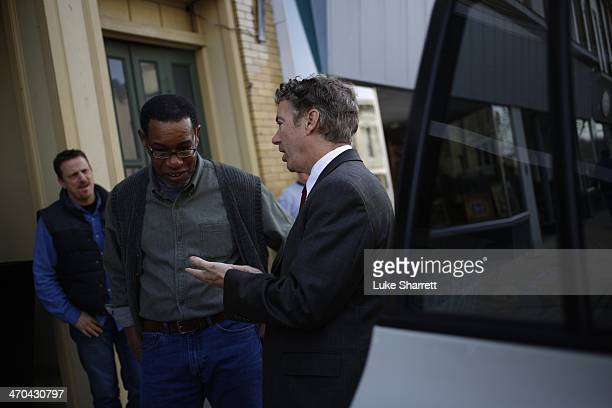 Senator Rand Paul speaks with a constituent after appearing at a meet and greet event at the Harvest Coffee and Cafe coffee shop on February 19, 2014...