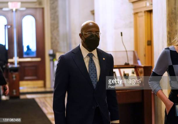 Senator Raphael Warnock arrives prior to the start of opening arguments on the second day of former President Donald Trump's second impeachment trial...