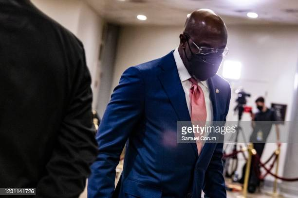 Senator Raphael Warnock walks through the Senate subway before the start of the fourth day in the Senates second impeachment trial of former...