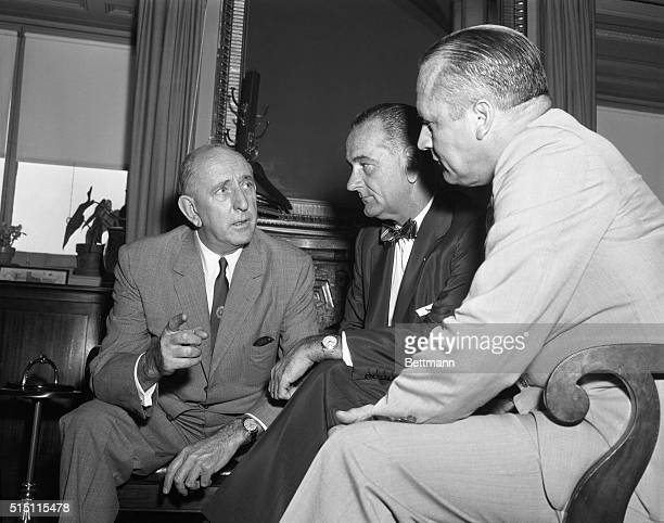 Senator Richard B Russell left number 1 opponent of the Civil Rights Bill is shown in a huddle with Senate Majority Leader Lyndon B Johnson center...