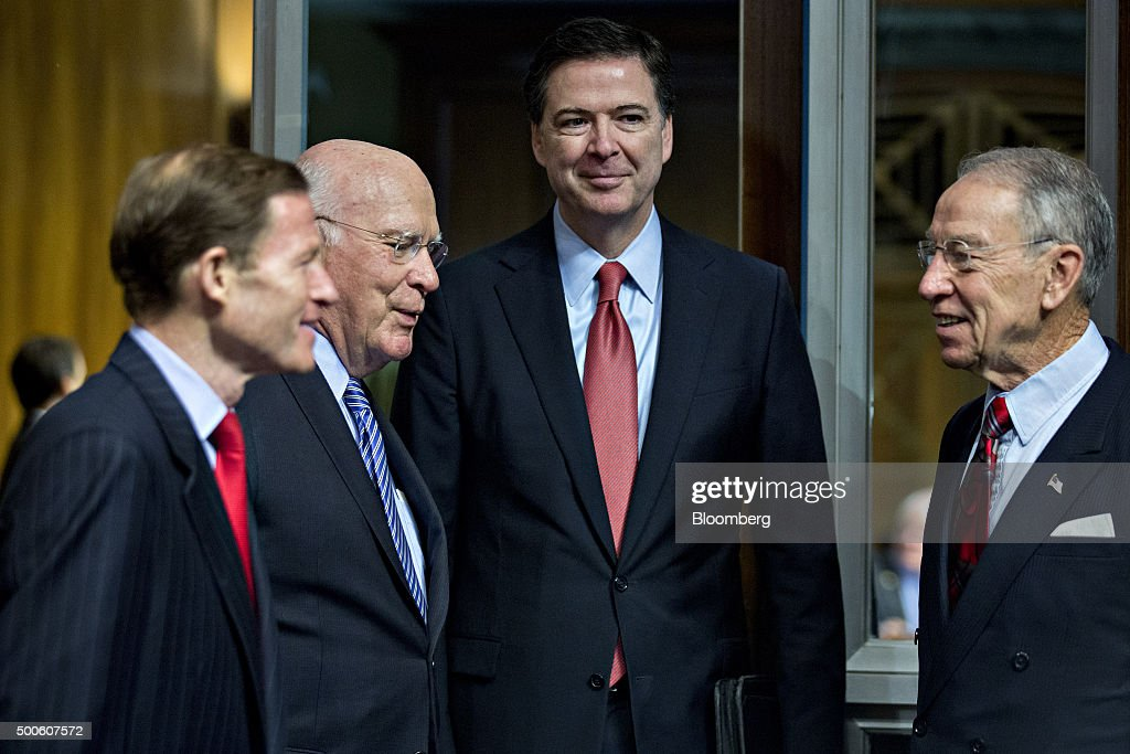 Senator Richard Blumenthal, a Democrat from Connecticut, from left, Senator Patrick Leahy, a Democrat from Vermont, James Comey, director of the Federal Bureau of Investigation (FBI), and Senator Charles 'Chuck' Grassley, a Republican from Iowa and chairman of the Senate Judiciary Committee, arrive to a Senate Judiciary Committee in Washington, D.C., U.S., on Wednesday, Dec. 9, 2015. The California couple who fatally shot 14 people last week in what authorities are calling a terror attack had become radicalized and discussed martyrdom at least two years ago, Comey said. Photographer: Andrew Harrer/Bloomberg via Getty Images