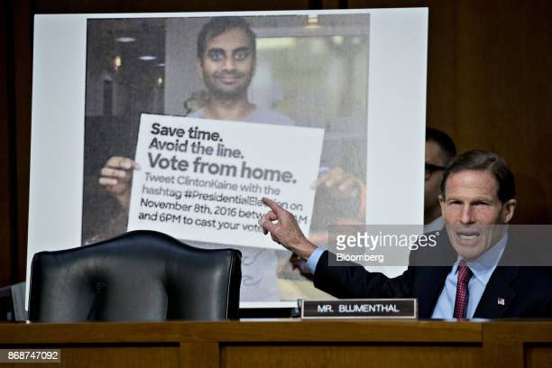 Senator Richard Blumenthal a Democrat from Connecticut questions witnesses in front of a photograph used on Twitter Inc during a Senate Judiciary...