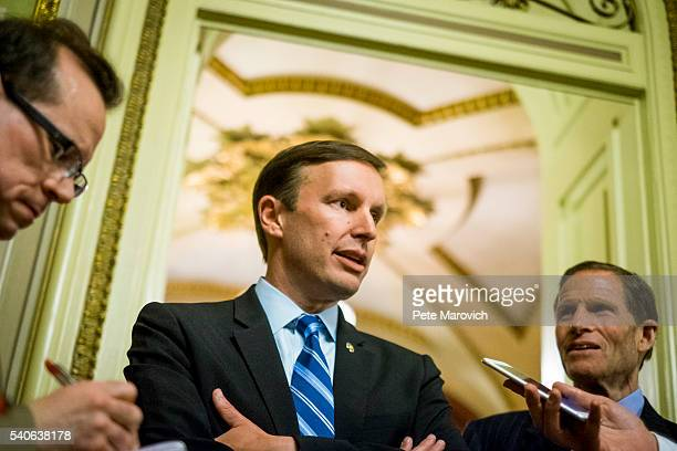 Senator Richard Blumenthal looks on as Senator Chris Murphy speaks to reporters after waging an almost 15hour filibuster on the Senate floor in order...