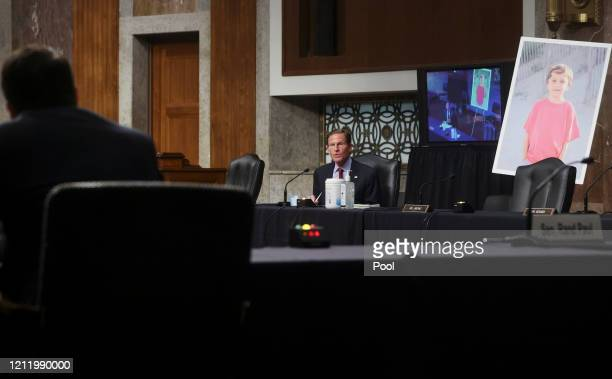 S Senator Richard Blumenthal questions Judge Justin Walker while displaying a photo of a young constituent from Ridgefield Connecticut named Conner...
