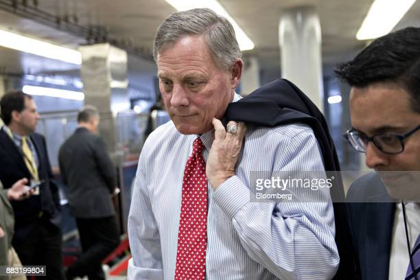 Senator Richard Burr a Republican from North Carolina speaks to a member of the media while walking through the basement of the US Capitol in...