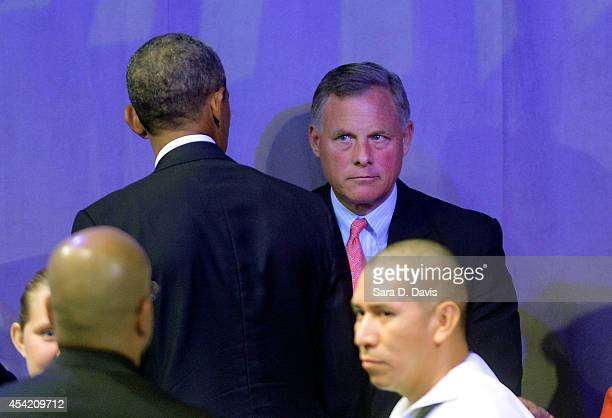S Senator Richard Burr looks at President Barack Obama following his speech at the American Legion National Convention on August 26 2014 in Charlotte...
