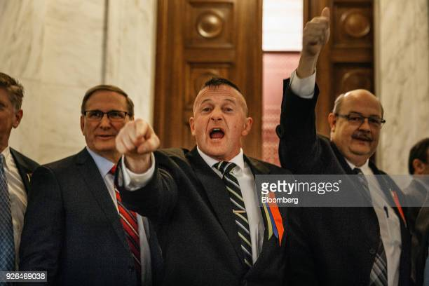 Senator Richard Ojeda, a Democrat from West Virginia, center, gestures to striking school workers inside the West Virginia Capitol in Charleston,...