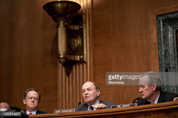 Senator Richard Shelby a Republican from Alabama center questions witnesses as Senator Mike Crapo a Republican from Idaho and chairman of the Senate...