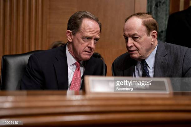 Senator Richard Shelby a Republican from Alabama right talks to Senator Patrick Toomey a Republican from Pennsylvania before a confirmation hearing...
