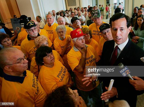 S Senator Rick Santorum speaks to people who came to protest the possible closure of bases after he testified at the Base Realignment and Closure...