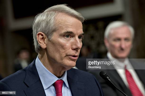 Senator Rob Portman a Republican from Ohio left introduces Jeffrey Rosen deputy transportation secretary nominee for US President Donald Trump during...