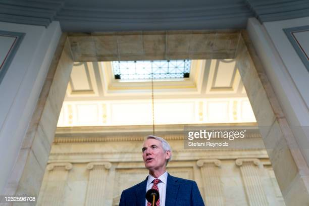 Senator Rob Portman speaks to members of the media while arriving to Senate Republican policy luncheon at the Russell Senate Office Building on April...