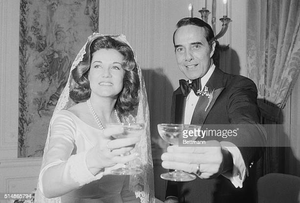 Senator Robert Dole and his second wife Elizabeth give a toast on their wedding day December 6 1975