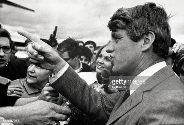 Senator Robert F Kennedy answers Where's your wife question by pointing back toward the plane he had just departed The New York Senator kicked off...