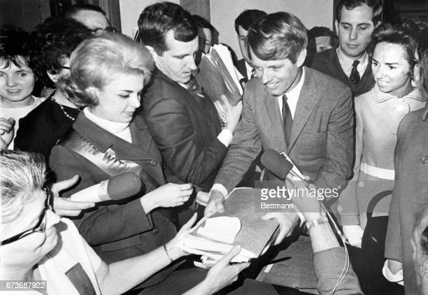 Senator Robert F Kennedy formally entered the Indiana presidential primary He came to the state capitol to sign papers and present Election Deputy...