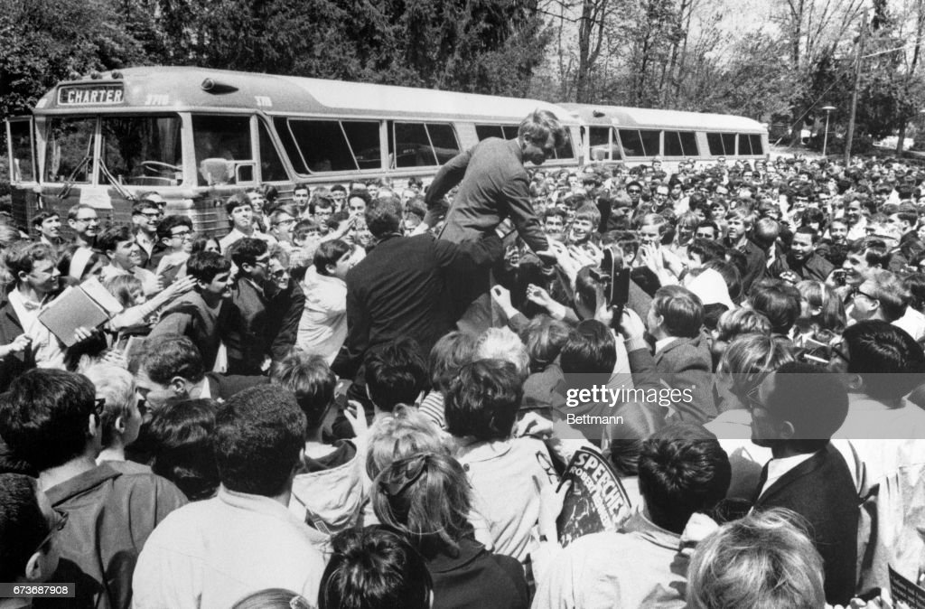 Senator Robert F. Kennedy got his most enthusiastic reception yet in his Indiana presidential primary campaign when he visited Indiana University. He was mobbed by thousands of students on the streets, while another 2,000 were jammed into an auditorium to hear him deliver an address on foreign policy.
