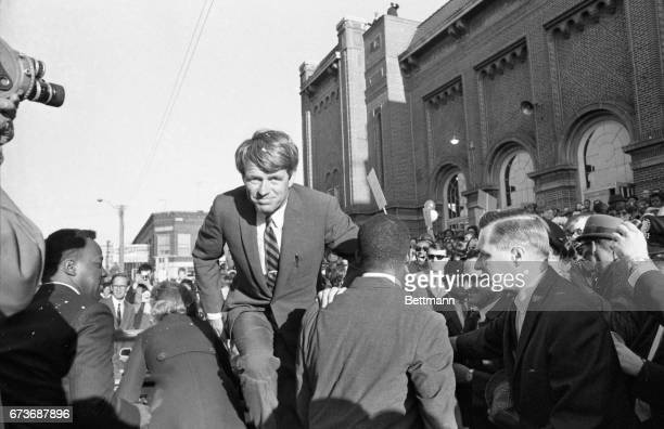 Senator Robert F Kennedy is seen getting out of his car at Memorial Auditorium after motorcading through the streets of downtown Gary Kennedy...