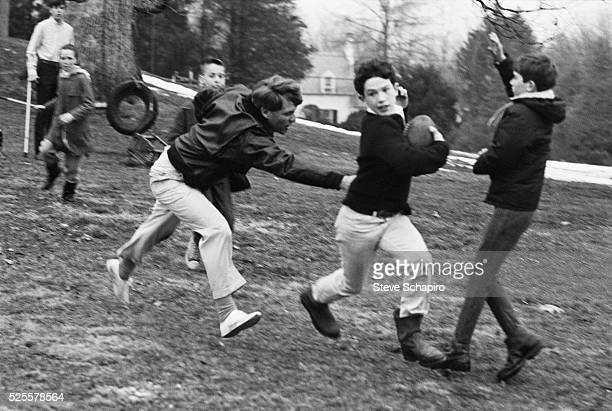 Senator Robert F Kennedy plays touch football with his children at Hickory Hill McLean Virginia December 24 1967