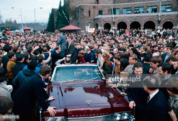 US Senator Robert F Kennedy stands in an opentop convertible as he greets supporters during his presidential campaign Indiana 1968