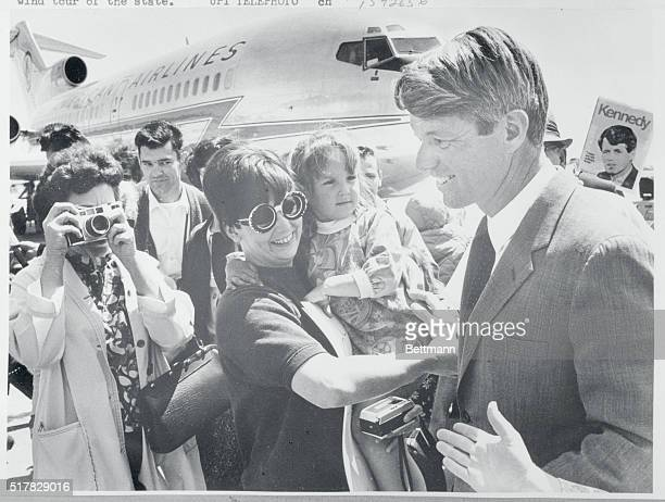 Senator Robert F Kennedy was greeted by a small crowd at Baer Field this noon as he arrived in Fort Wayne for his last appearance before the Indiana...