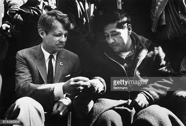 Senator Robert Kennedy breaks bread with Union Leader Cesar Chavez as Chavez ended a 25-day fast in support of non-violence in the strike against...