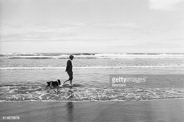 Senator Robert Kennedy leaves the cares of campaigning for the Democratic presidential nomination behind for a little while, as he and his dog,...