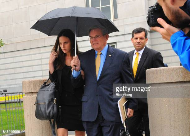 Senator Robert Menendez a Democrat from New Jersey center and his daughter Alicia Menendez left exit federal court in Newark New Jersey US on...