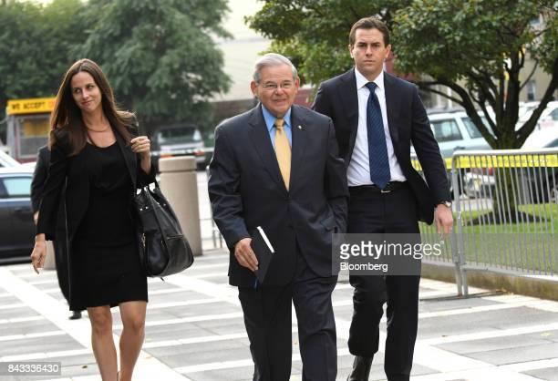 Senator Robert Menendez a Democrat from New Jersey center arrives at federal court with his children Alicia Menendez left and Robert Jr Menendez in...