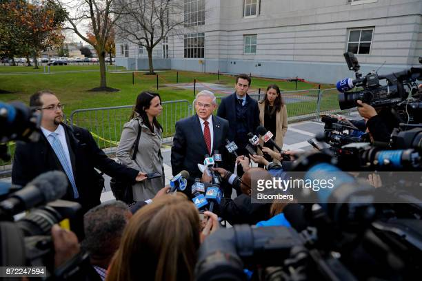 Senator Robert Menendez a Democrat from New Jersey center speaks to members of the media while exiting federal court in Newark New Jersey US on...