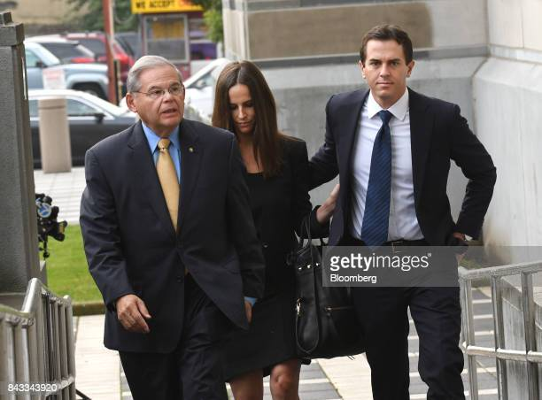 Senator Robert Menendez a Democrat from New Jersey left arrives with his children Alicia Menendez center and Robert Jr Menendez at federal court in...