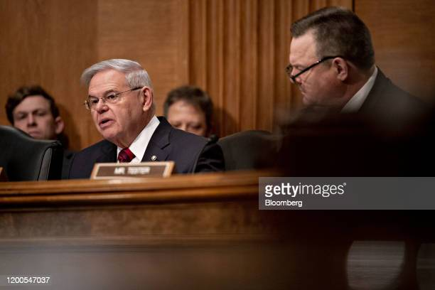 Senator Robert Menendez a Democrat from New Jersey questions witnesses as Senator Jon Tester a Democrat from Montana right listens during a Senate...