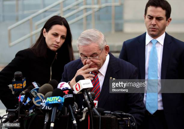 Senator Robert Menendez a Democrat from New Jersey reacts while speaking to members of the media outside federal court in Newark New Jersey US on...