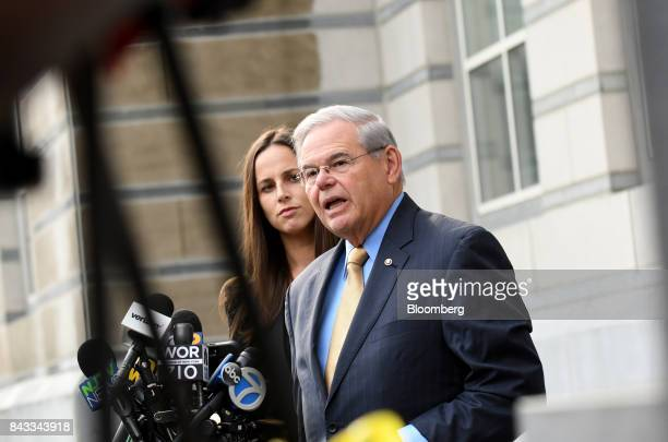 Senator Robert Menendez a Democrat from New Jersey right speaks to members of the media outside federal court with his daughter Alicia Menendez in...