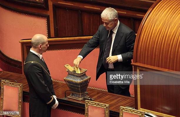 Senator Roberto Formigoni votes for the president of Senate during the Italian Parliament inaugural session at Senate on March 15 2013 in Rome Italy...