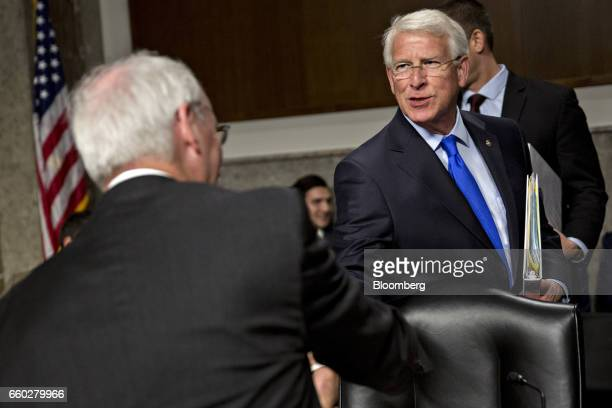 Senator Roger Wicker a Republican from Missouri right shakes hands with Jeffrey Rosen deputy transportation secretary nominee for US President Donald...