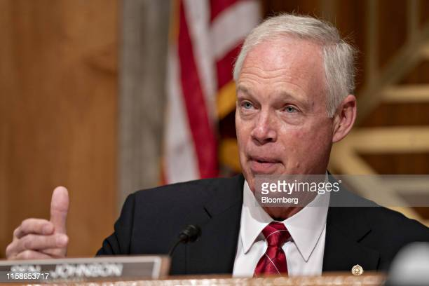 Senator Ron Johnson a Republican from Wisconsin and chairman of the Senate Finance Committee makes an opening statement during a hearing on migration...