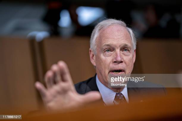 Senator Ron Johnson a Republican from Wisconsin questions Dennis Muilenburg chief executive officer of Boeing Co not pictured during a Senate...