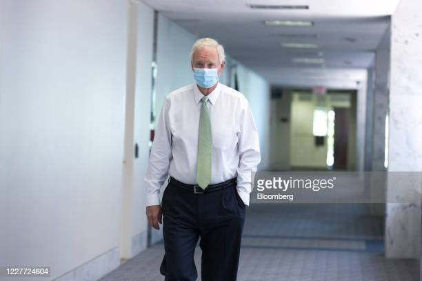 Senator Ron Johnson a Republican from Wisconsin wears a protective mask while arriving to the Senate Republican policy luncheon on Capitol Hill in...