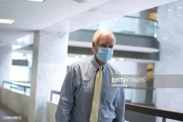 Senator Ron Johnson a Republican from Wisconsin wears a protective mask while arriving to the Senate Republican luncheon on Capitol Hill in...