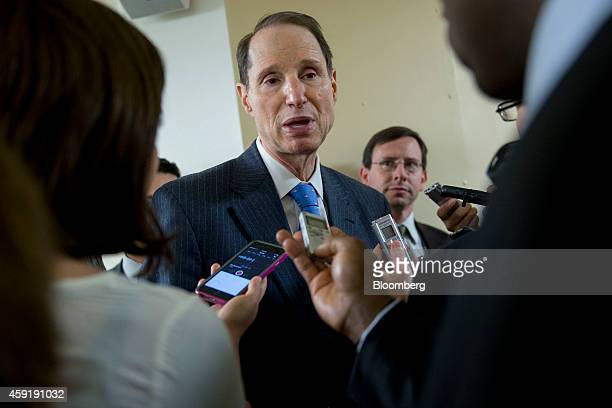 Senator Ron Wyden a Democrat from Oregon center talks to members of the media at the US Capitol Building in Washington DC US on Tuesday Nov 18 2014...