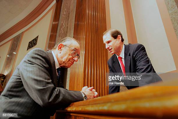 Senator Ron Wyden speaks with Federal Reserve Chairman Alan Greenspan during a hearing on USChina Economic Relations June 23 2005 in Washington DC...