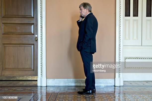 Senator Roy Blunt a Republican from Missouri talks on a mobile device outside a meeting at the US Capitol in Washington DC US on Thursday July 19...